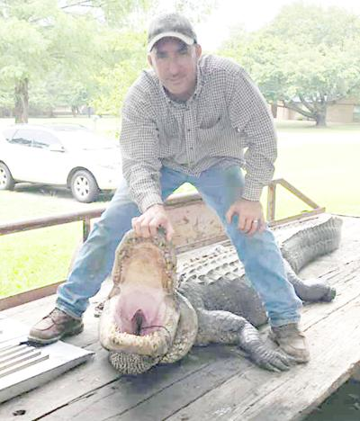 Outdoors: Father-son team takes 11-foot gator In Smith County