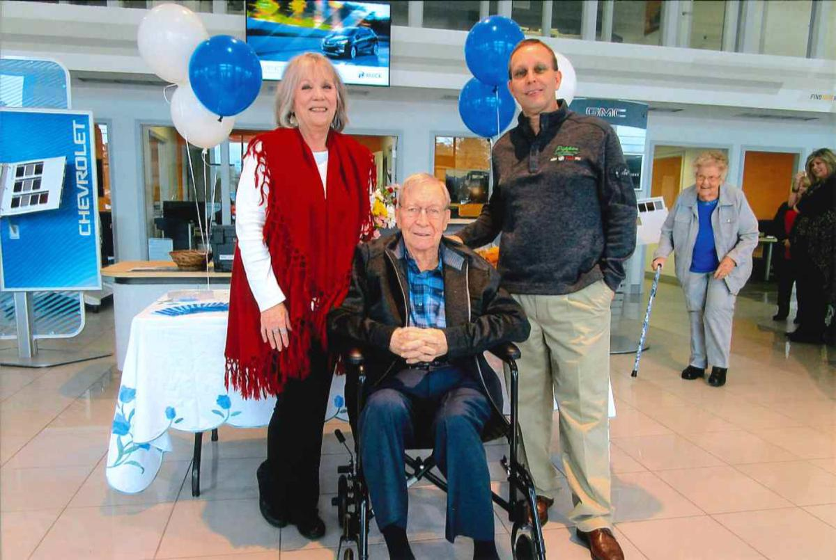 Linda Hook is pictured with Pippen Motor Company Co-Owner John W. Cooke and Executive General Manager Joh Cooke III.