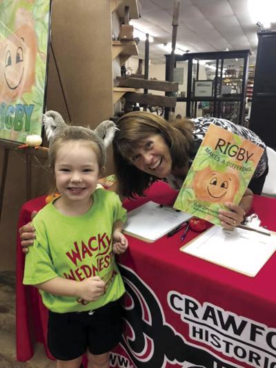 SEK pumpkin farmer writes children's book that carries a message for readers
