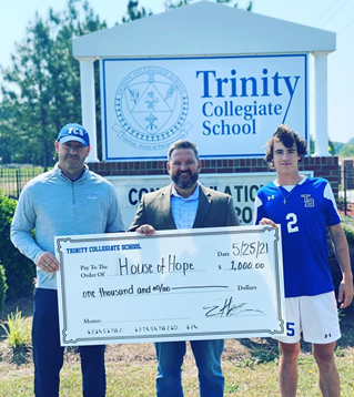 Trinity Collegiate School Varsity Soccer Team donated $1,000 to the House of Hope