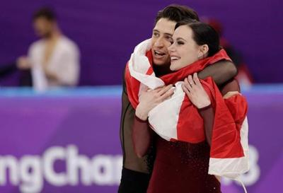 "Canadian stars Virtue, Moir say in video they're ""stepping away"" from ice dancing"