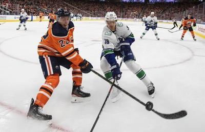 Turris scores winner in shootout to lift Oilers 3-2 over Canucks in season opener
