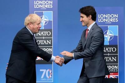 UK signs trade deal with Canada to prepare for Brexit