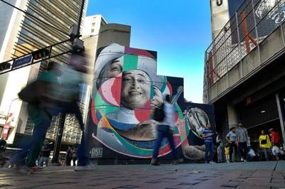 AP PHOTOS: Venezuelan street artist seeks to inspire