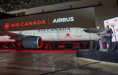 Eyeing U.S. and domestic markets, Air Canada unveils first Airbus A220 jet