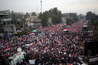 Iraqis rally against US troops, demanding they leave