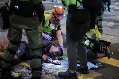 Hong Kong police shoot protester, man set on fire