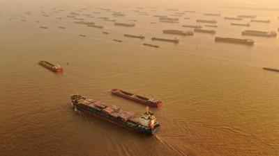 China 2020 exports up despite virus; surplus surges to $535B