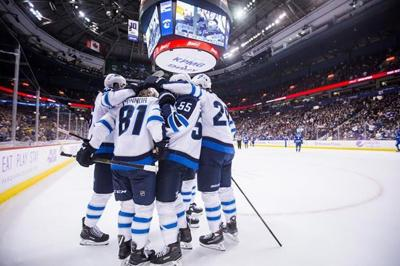 d59b6a0fa95 Laine s hat trick lifts Winnipeg Jets to 6-3 win over Vancouver Canucks