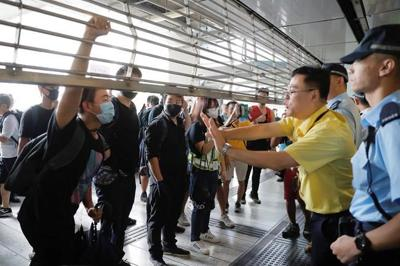 Hong Kong police and protesters clash, ending violence lull