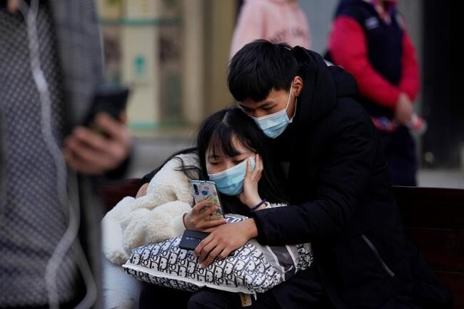 Asia Today: China virus cases spike as WHO researchers visit