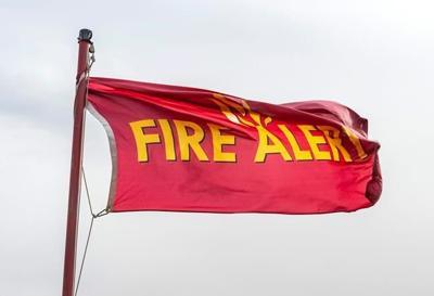 Fierce California winds fan fires, topple trees and trucks