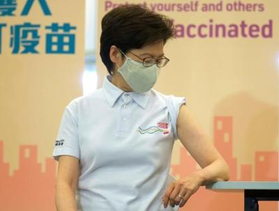 Hong Kong leader, other officials receive COVID-19 vaccine
