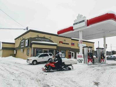 Second day of search yields no sign of French snowmobilers missing in Quebec