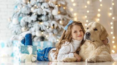 girl with a golden retriever dog