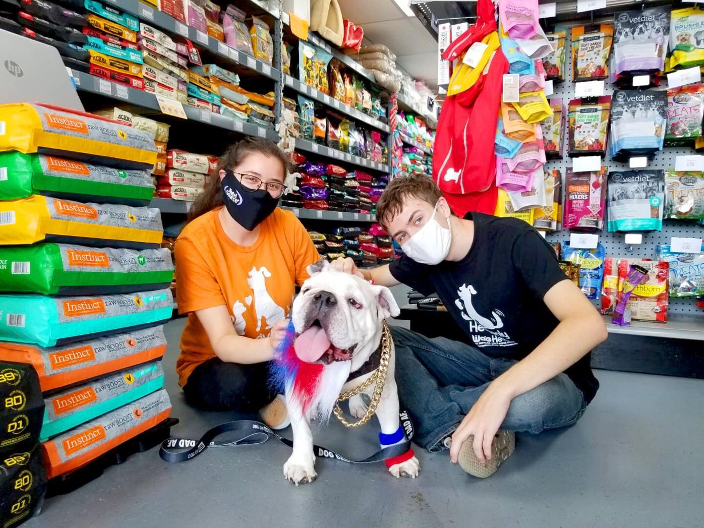 Staff Members Marissa Mendoza and William Wooten with regular customer Bronson.jpg