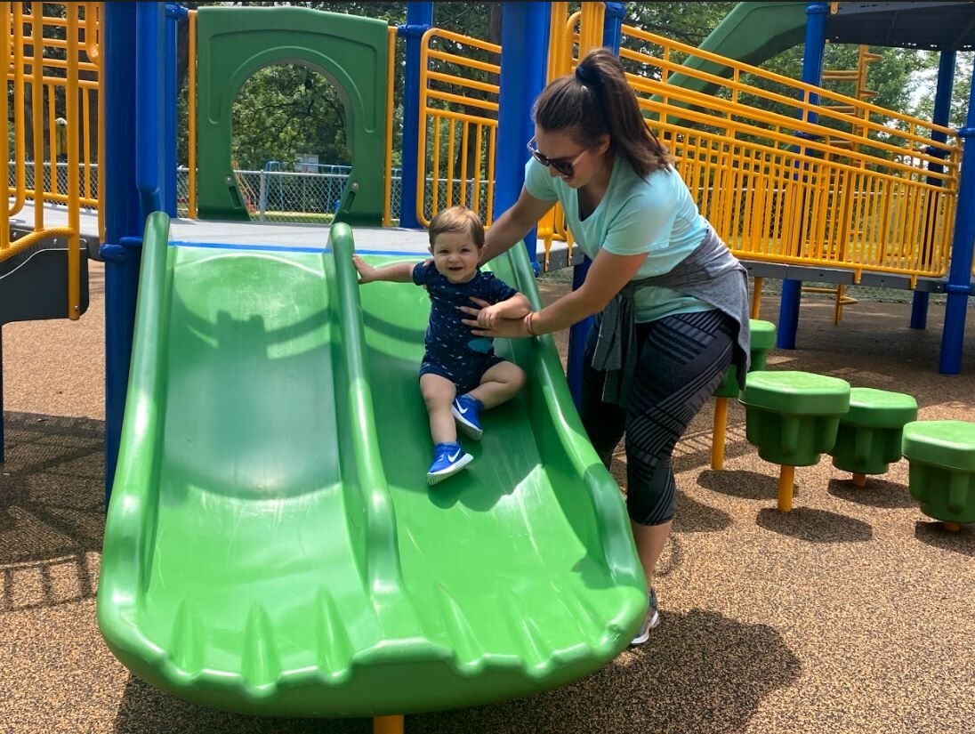 Micaiah and mother Rebecca at the new playground.JPG