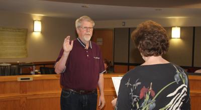 City Clerk Carol Daniels swears Monty Jordan into office