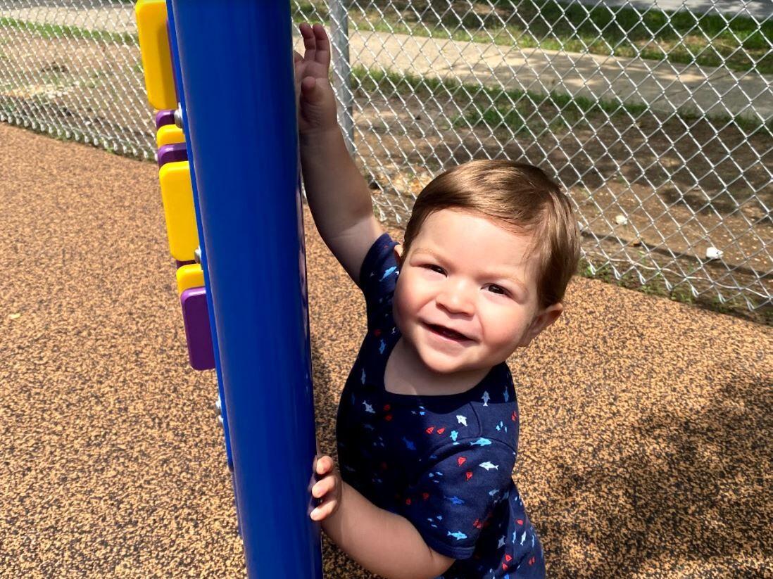 Micaiah at the new playground.JPG