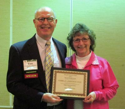 Cole receives education award