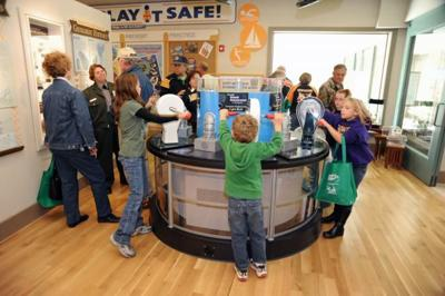 Visitors interact with exhibits and rangers at the M.W. Boudreaux Memorial Visitor Center Mark Twain Lake