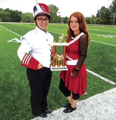 Rebecca Lewis and Aubrey Wendel accept marching festival trophy