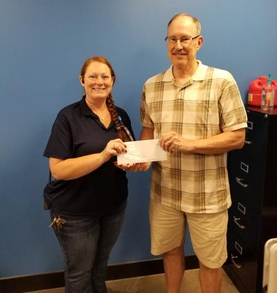 Wal-Mart's Bowling Green store Assistant Manager Beth DeCamp Raspberry presents the Community Grant check to Walter Logan, the Buffalo Township United Fund's board president