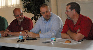 Pike County Commissioners Bill Allen, Justin Sheppard, and MoDOT's Northeast District Design Engineer Tom Batenhorst.