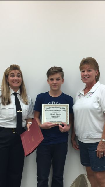 Brady Pitzer receives Kids Doing the Right Thing Award