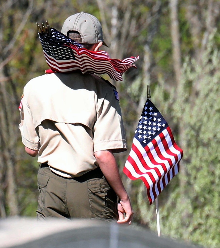 Scout and Cub Pack 302 places Memorial Day flags