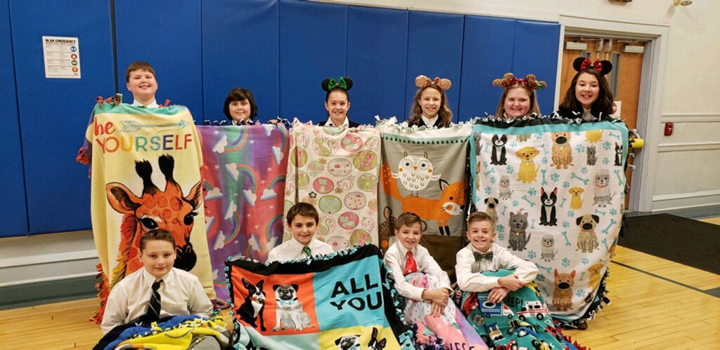 Holy Rosary donates blankets, Christmas stockings to children's hospital