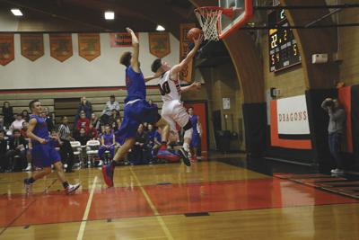 DALLAS ROUNDUP: Boys basketball opens league play with win