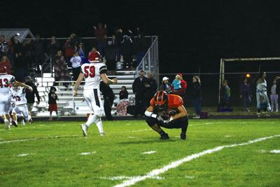 PREP FOOTBALL: Rebels rally in fourth quarter to stun Dragons