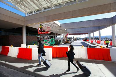 Work hums along at airport, with a few bumps along way