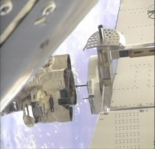 Astronauts install big magnet on space station