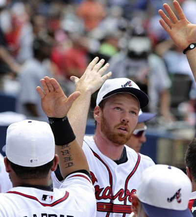 Braves surge into first in NL East