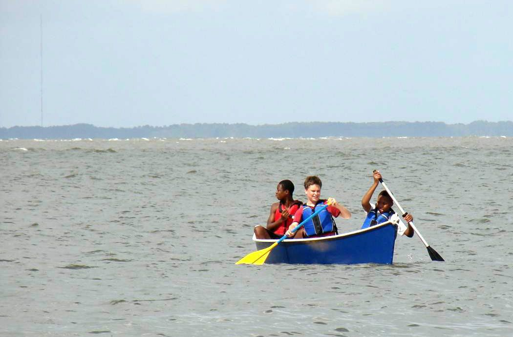 Novice 8th-graders take ride in boat they built