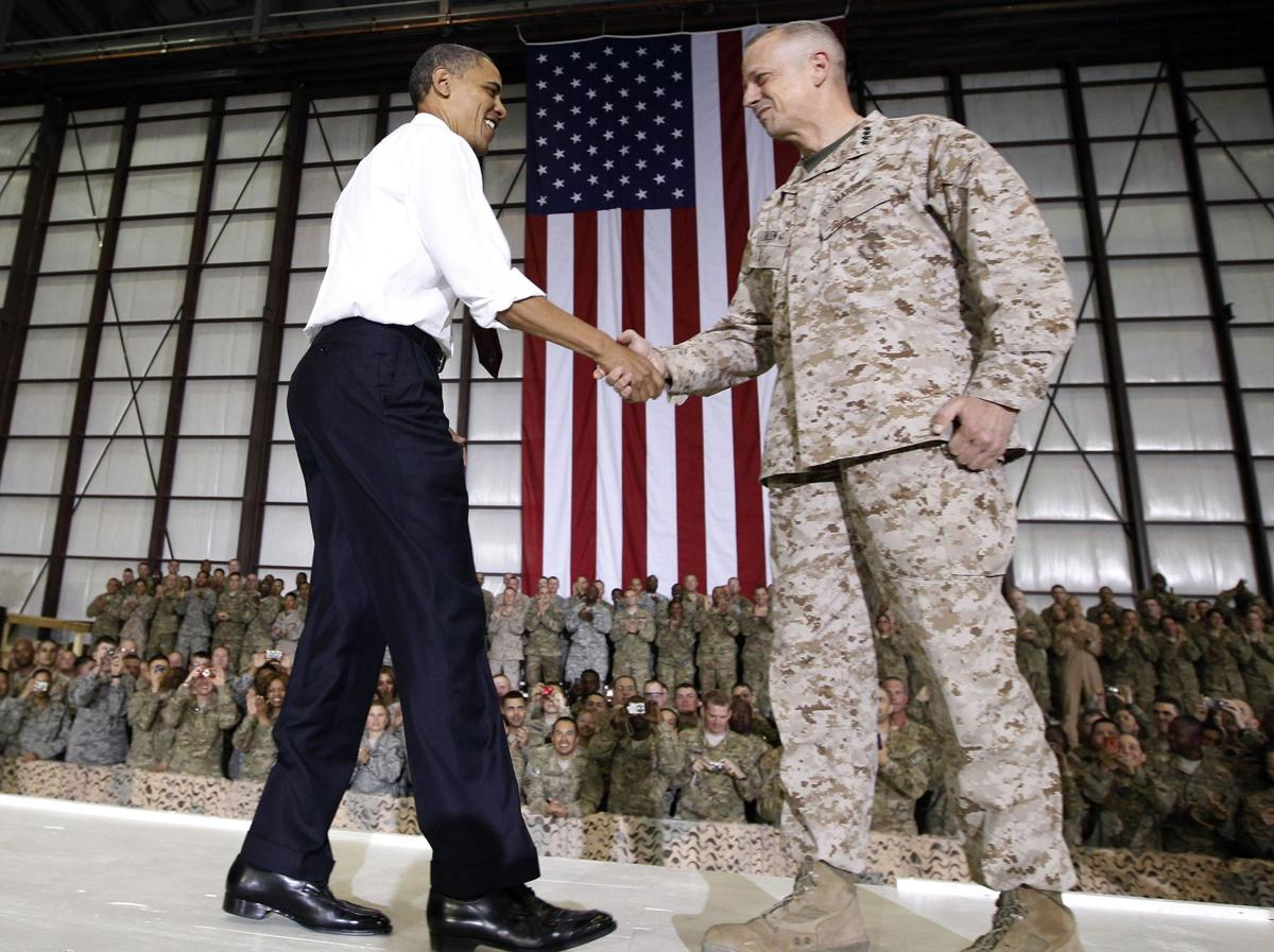 Obama drops in on troops