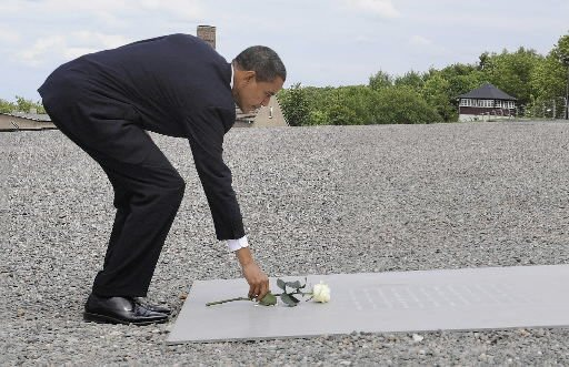 Obama tours camp, honors 56,000