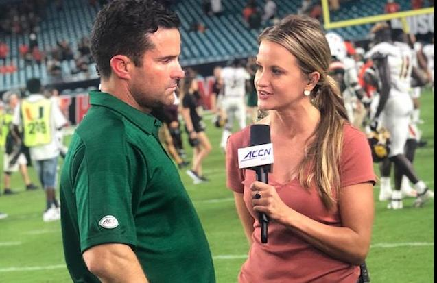 Kelsey Riggs with Manny Diaz