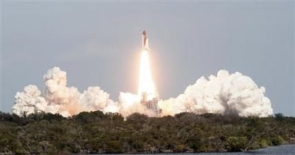 Shuttle Atlantis blasts off