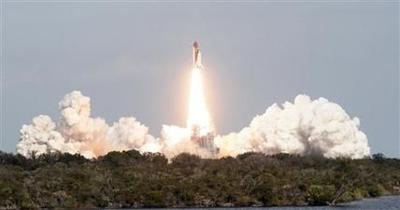 Shuttle Atlantis blasts off