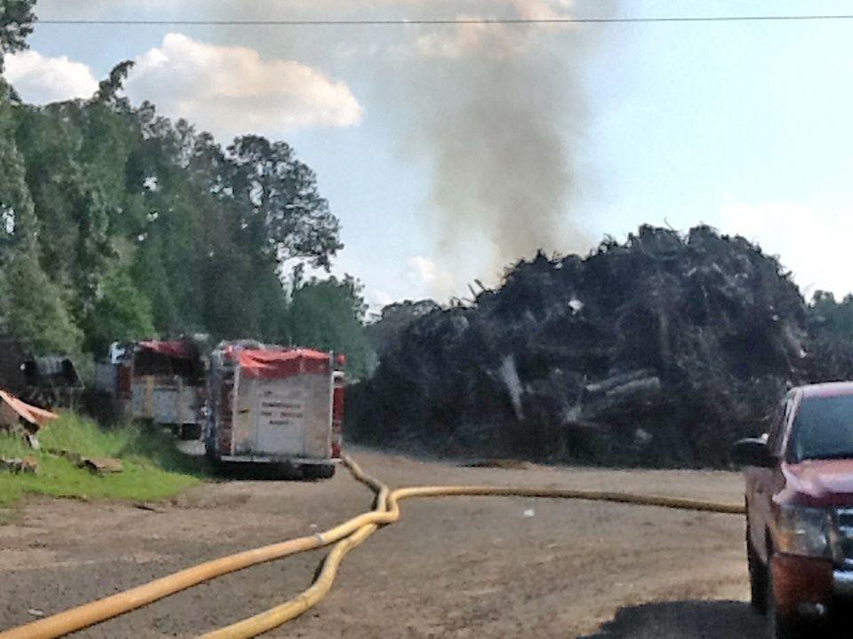Mulch fire smolders on Highway 78