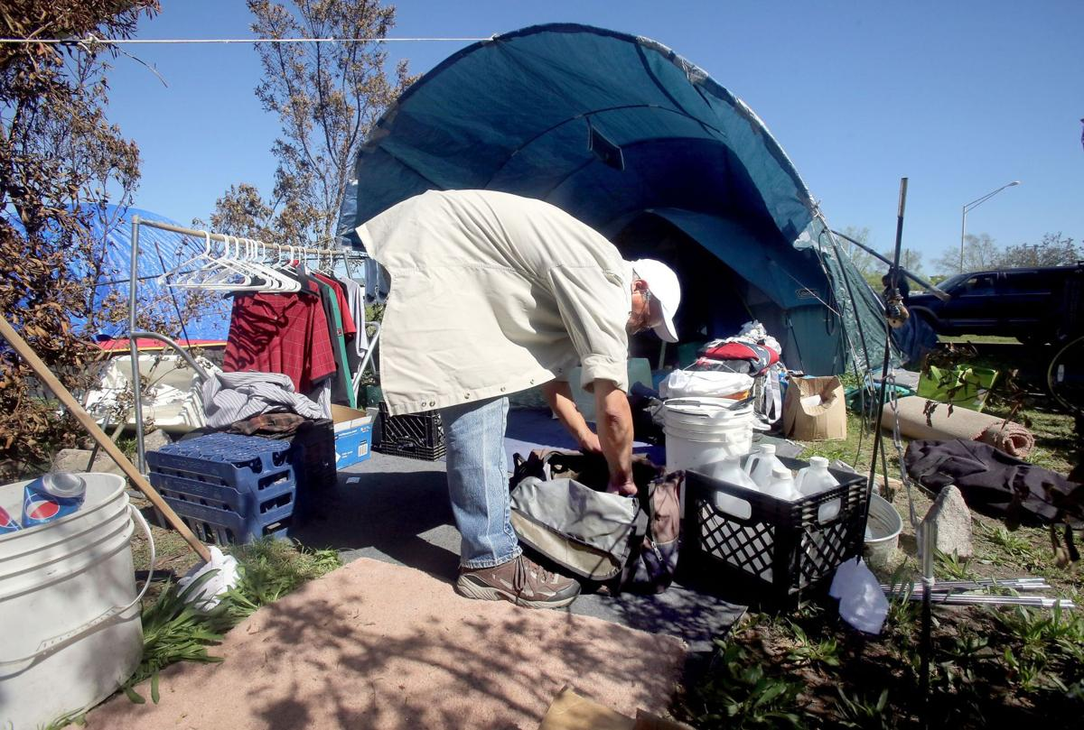 City officials begin moving homeless out of Tent City