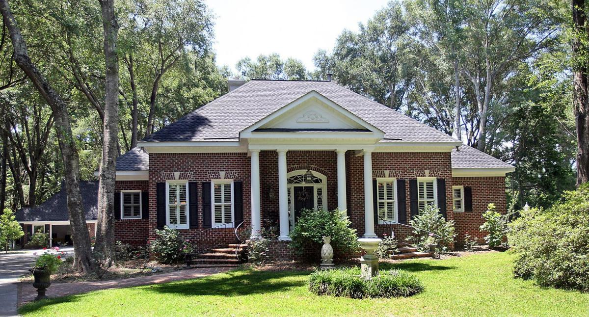 3340 River Landing Road Historic-style brick house in wooded Johns Island neighborhood showcases host of attractions