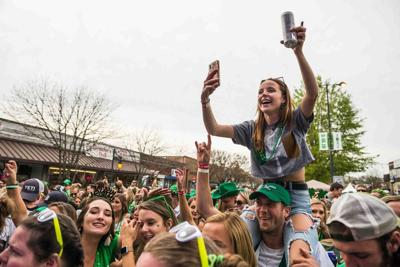 Five Points St. Pats crowd girl on shoulders 2019 (copy)