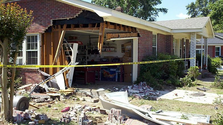 Worst fears realized as car trashes garage