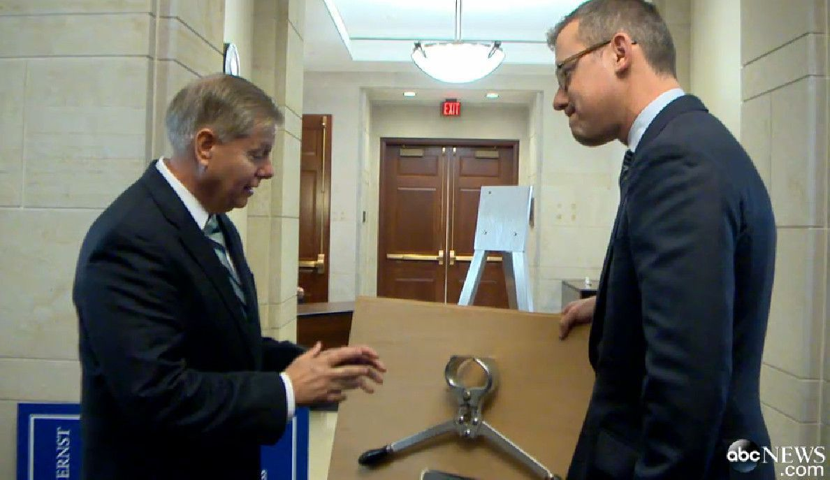Lindsey Graham welcomes Joni Ernst to the Senate with a castration device