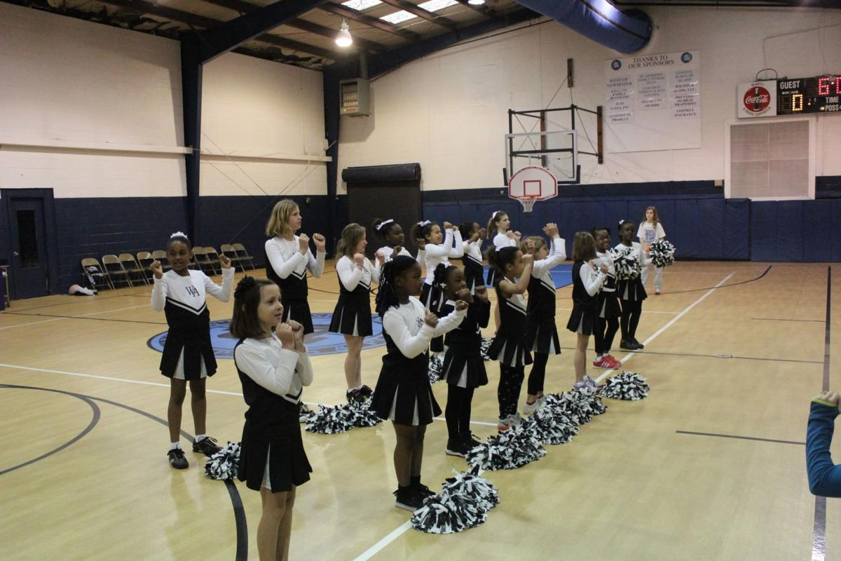 St. Andrew's cheerleaders show skills at expo