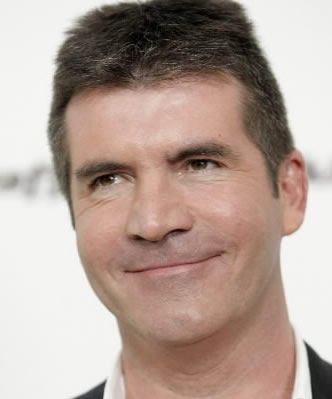 Cowell not leaving 'Idol' just yet
